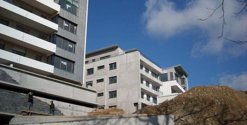 chantier avec visite d'un courtier immobilier